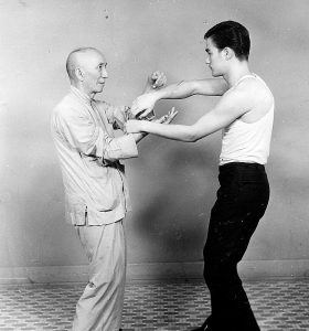 Bruce lee and Yip Man in chi sau